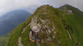 Middle age man hiking in Switzerland mountains stock video footage