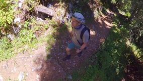 Middle age man hiking in Switzerland mountains stock video