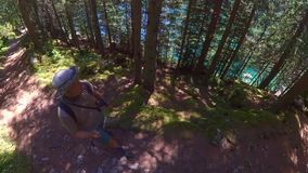 Middle age man hiking in Switzerland mountains stock footage