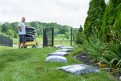 Middle Age Man Mulching his House Backyard Royalty Free Stock Photo