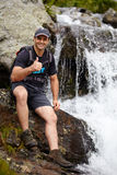 Middle age man near a waterfall Stock Image