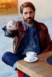 Middle age man paying card in a restaurant. Portrait of handsome hipster man paying for his coffee with a credit card at the cafe, customer paying at a coffee royalty free stock photos