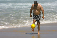 Middle age man playing with a ball Stock Photo