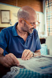 Middle age man reading newspaper Royalty Free Stock Photo