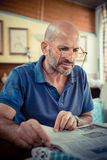 Middle age man reading newspaper Stock Photo