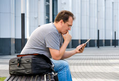 Middle age man reading tablet stock image