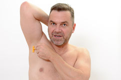 Middle-age man shaving his underarm Royalty Free Stock Images