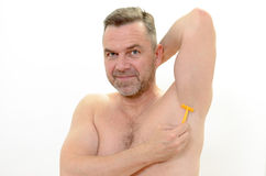 Middle-age man shaving his underarm Stock Photo