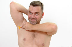 Middle-age man shaving his underarm Royalty Free Stock Photography