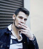 Middle age man smoking cigarette on bacyjard, stylish tough guy, lifestyle people concept Stock Images