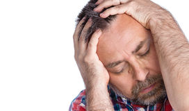 Middle age man suffering from a headache Royalty Free Stock Photos