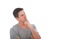 Middle Age Man Thinking with Finger on Lips. Close up Handsome Middle Age Man Thinking of Something with Finger on Lips. Isolated on White Background Stock Images