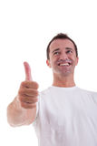 Middle-age man with thumb raised as a sign of succ Stock Photography
