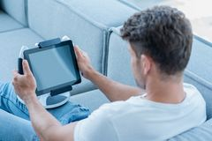 Middle Age Man Using Cool Tablet at Couch Royalty Free Stock Images