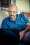 Middle age man using notebook Stock Photos