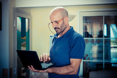 Middle age man using notebook Stock Photo