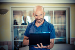 Middle age man using notebook Royalty Free Stock Photo