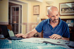 Middle age man using notebook Royalty Free Stock Photos