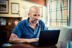 Middle age man using notebook Royalty Free Stock Images