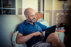 Middle age man using notebook Stock Image