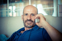 Middle age man using phone Stock Photo