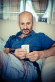 Middle age man using phone Royalty Free Stock Images