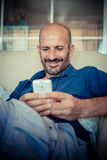 Middle age man using phone Stock Photos