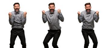 Middle age man wearing a suit. Middle age man, with beard and bow tie happy and excited celebrating victory expressing big success, power, energy and positive Stock Photos