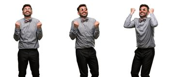 Middle age man wearing a suit. Middle age man, with beard and bow tie happy and excited celebrating victory expressing big success, power, energy and positive Royalty Free Stock Image