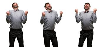 Middle age man wearing a suit. Middle age man, with beard and bow tie happy and excited expressing winning gesture. Successful and celebrating victory Royalty Free Stock Images