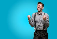 Middle age man wearing a suit. Middle age man, with beard and bow tie happy and excited expressing winning gesture. Successful and celebrating victory Stock Photos