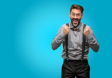 Middle age man wearing a suit. Middle age man, with beard and bow tie happy and excited expressing winning gesture. Successful and celebrating victory Stock Photography