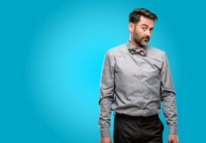 Middle age man wearing a suit. Middle age man, with beard and bow tie having skeptical and dissatisfied look expressing Distrust, skepticism and doubt stock photography
