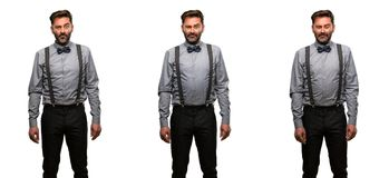 Middle age man wearing a suit. Middle age man, with beard and bow tie with sad and upset expression, unhappy Stock Photography