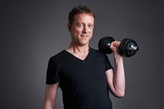 Middle age man with weights Stock Photography
