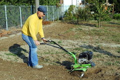 Middle Age Man With A Rototiller Stock Image