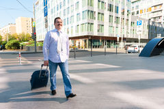 Middle age manager walking Royalty Free Stock Photography