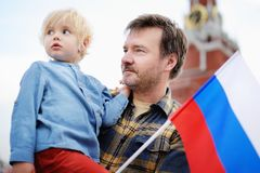Middle age men and his little son with russian flag Royalty Free Stock Photography