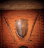 Middle age metallic shield and two swords