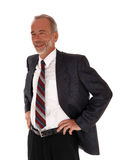 Middle age professional man standing smiling. Stock Photos