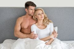 Middle Age Romantic Couple on Bed Fashion Shoot Stock Photo