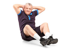 A middle age senior man exercising. On white background Royalty Free Stock Image