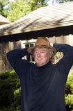 Middle age senior man with fashionable hat in yard Stock Image