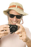 Middle age senior tourist male. Wearing funny sun hat and taking picture with digital camera Royalty Free Stock Photography
