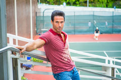 Middle Age Strong, Health American Man waiting for you at tennis Stock Photo