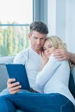 Middle Age Sweet Couple Using Blue Tablet Stock Photography
