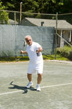 Middle age tennis player forehand on court Royalty Free Stock Photo