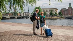 Middle age tourist couple standing in the center of Stockholm and looking at map, back view, Stockholm, Sweden, august 2018 stock images