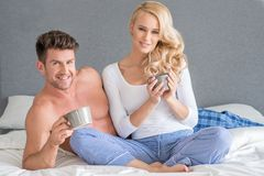 Middle Age White Couple Having Drink on Bed Royalty Free Stock Photo