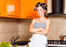 Middle-age woman with apron in the kitchen. Middle-age woman housewife in the kitchen Royalty Free Stock Photos